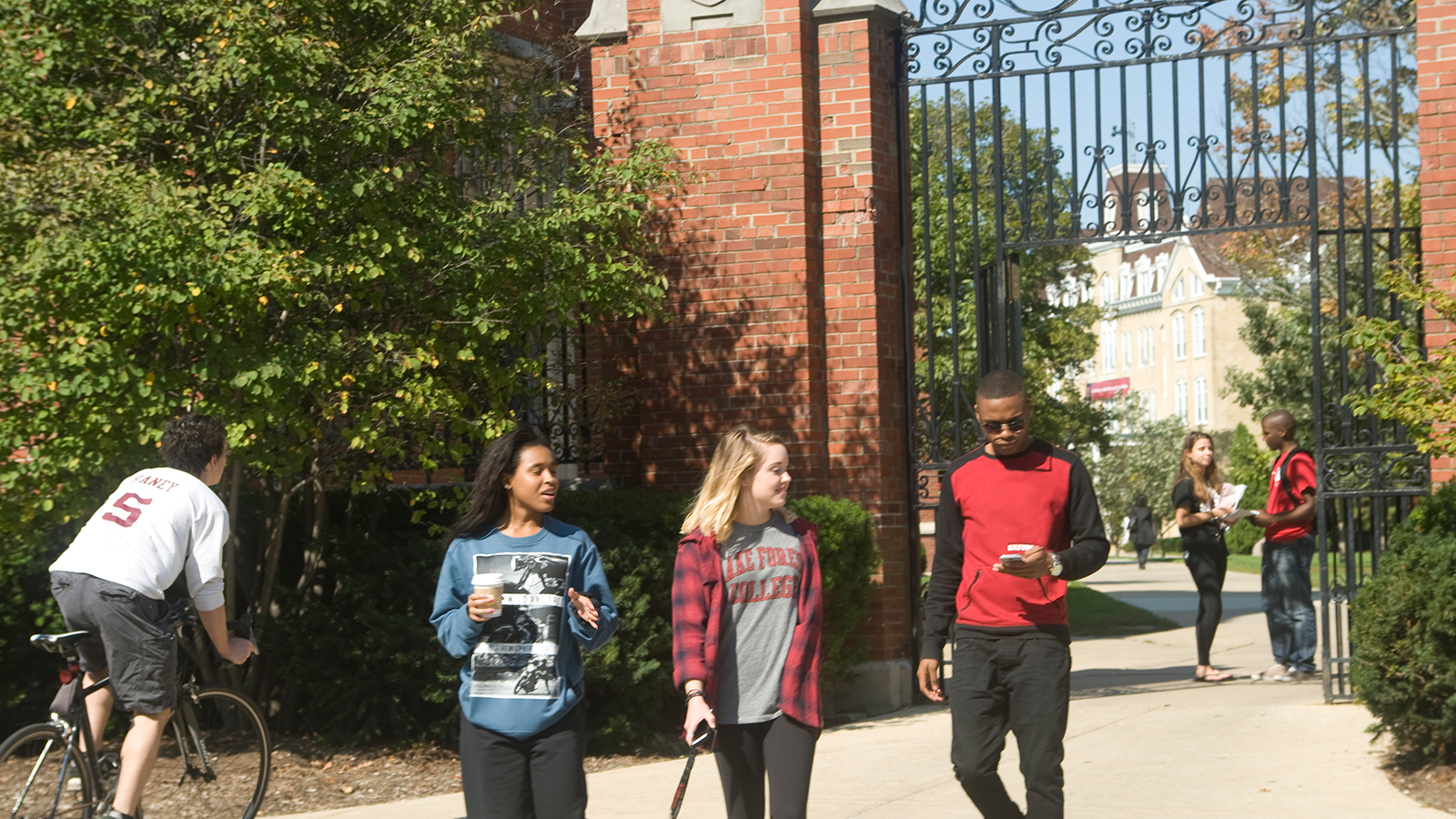Students walking through the gates at the College