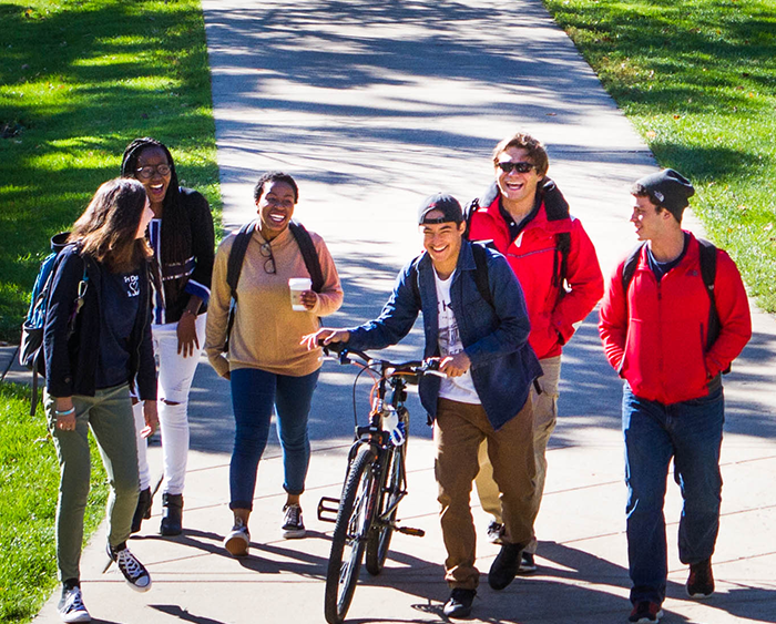 A group of students walking through campus.