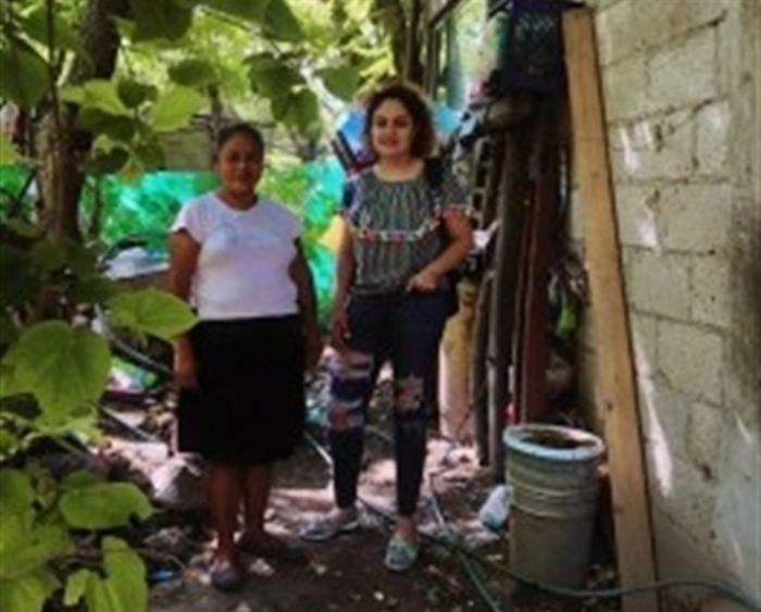 Carolina Guadarrama '19 and woman in Alpuyeca, Morelos, Mexico, in front of installed water filters