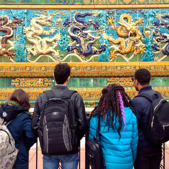 Students looking at a Chinese monument