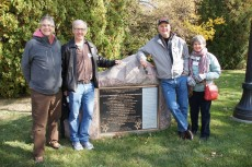 The members of the Class of 1977 pose for a picture next to the rock memorializing Dr. Seuss's famous commencement address...