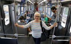 "Poet Lois Baer rides a CTA Red Line ""L"" train in Chicago on Sept. 12, 2019. She finds inspiration on the"