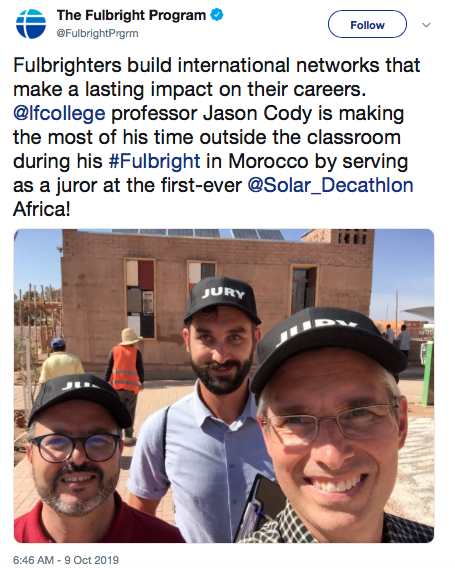 Fulbrighter and Professor Jason Cody (right) judged college students' solar home designs in a competition in Africa, which was picked up by the national Fulbright program and shared on Twitter.