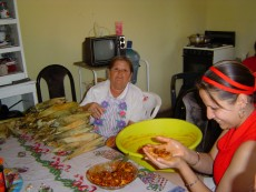 A maquiladora worker makes tamales during an interview.