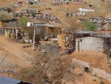 This shanty town is typical of the neighborhoods where factory workers live.