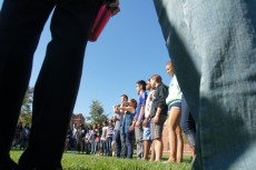 Students listen to the rules of the next ice breaker - a game designed to reveal that, despite their differences, they are...