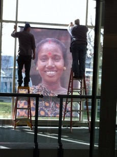 Facilities Management staff install huge photographs around campus for Islamic World Studies' week-long program, Portrai...