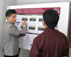 Neuroscience and educational studies junior Charles Alvarado '16 presents his Parkinson's disease research to other scient...