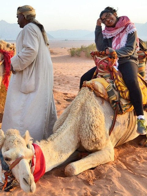 a student on a camel while studying abroad