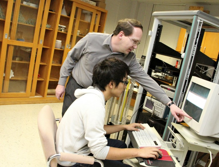 Students learn to control experimental equipment with the LabView programming language in Professor Mueggenburg's lab.