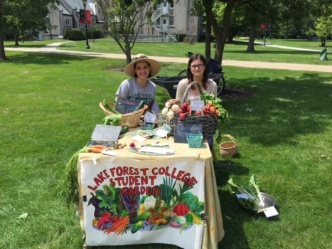 Isabelle Carrot '19 (left) and Olga Gutan '19 (right) sell produce at the Middle Campus Market
