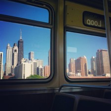 The Chicago skyline from a train.