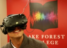 A student explores virtual reality in Lake Forest College's VirtualSpace.