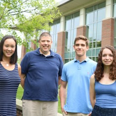 Amanda Lee '21, Professor of Economics and Business Robert Lemke, Jan Roessler '21 and Molly Gniady '21