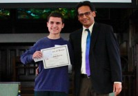 Professor Shubhik DebBurman congratulates Stuart Lukz of Stevenson High School on his first place win.