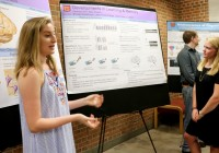 High school student Kennedy Kerr (left) and transfer student Katy Shadek '20 present results of their memory and learning ...