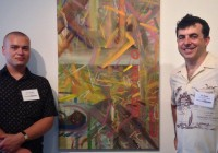 Kirk Gilbert '16 of Chicago (left) and Associate Professor of Art and Chair of Art and Art History Eli Robb at the exhib...