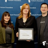 "Patricia ""Trish"" Thomas (center) accepts the award as top entrepreneurship professor in the state from..."
