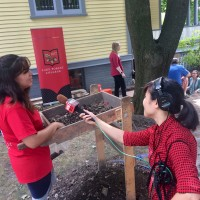 Susie An of National Public Radio interviews Jennifer Cabrera '18 during the Archaeological Field School Media day on July...