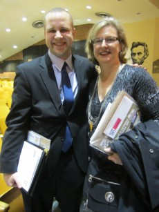 Josh Bill '04 poses with Professor of Education Dawn Abt-Perkins, who attended the award ceremony.