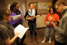 Students in Edgar's class Introduction to Teaching and Learning Music prepare to teach a lesson on how to tune a ukulele.