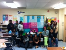 "Weidner (front middle) poses with her sophomore high school students in front of the class ""ofrenda,"" or Day of ..."