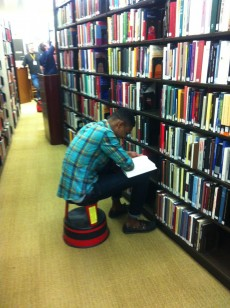 Richard Fordwor '16 researches the effects of recession on adulthood at Northwestern University's library as part of h...