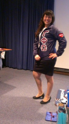 Anali Vargas '14 poses for a picture wearing her sorority's letters. She is a founding member of the Latina-oriented sor...