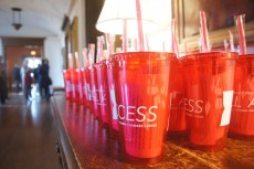 "Reception-goers received a free ""Philanthropy Provides All-Access"" tumbler cup as a thank you for offering their finan..."