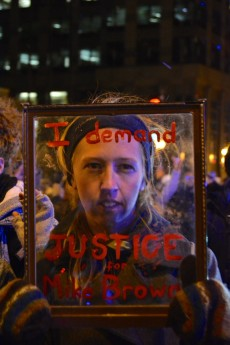 "Art major Izzy Pieniadz '15 ""threw herself into the protest"" to document the events in Chicago."