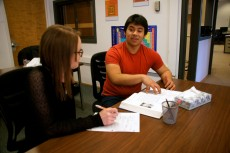 Saul Bello Rojas '16 tutors Marina Rawlings '17 in chemistry. Rojas wrote a case study that will be presented to internati...