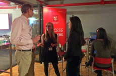 In The Loop students Savitra Beaver '15 (from right) and Marisa Miller '15 network with Doug Doolittle '80 during the All-...