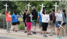 Border Studies students participate in a vigil at the official border entry in Douglas, Ariz.