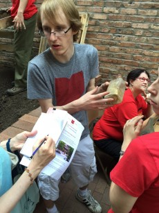 Xhris Fitzgerald '17 answers a reporter's question about artifacts found during the excavation.