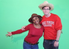 Hella Habtewold '16 and Connor Fahey '17 goof around in front of a green screen during Global Fest 2015.