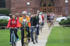 Harvey Cain '52 leads the celebratory ride from North Campus.