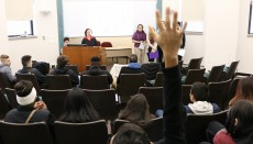 First-Year Studies students present findings of their study of Von Steuben High School to some of the visiting study parti...