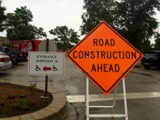 Signs, sidewalks, and ramps were installed this week for entrance to the Johnson Science Center during construction.