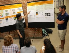 Isaac Ordonez '19 (left) talks about emotion, a project he worked on with transfer student Patrick Nolan (right).
