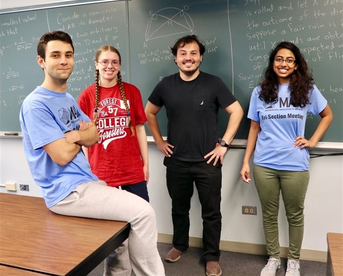 Kaloyan Parvanov '20 (from left), Emma Juettner '20, Assistant Professor of Mathematics Enrique Treviño, and Dipika Subra...