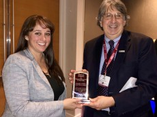 Associate Professor Amanda J. Felkey accepts an award for best article published in The American Economist in 2018.