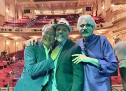 "Ahmad Sadri (center) with music virtuosos Yo-Yo Ma (left), and Keyhan Kalhor after a performance of ""Heroes Take Their Stands."""