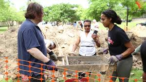 Paula Pelletier (right) works on the excavation of the Mecca Flats.