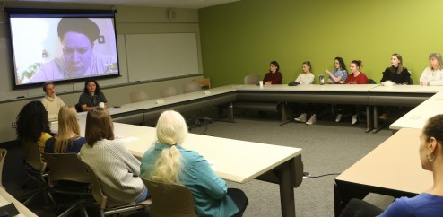 Associate Professor Chloe Johnston engaging with students, faculty, and alumni—one via Skype—during a recent book talk.